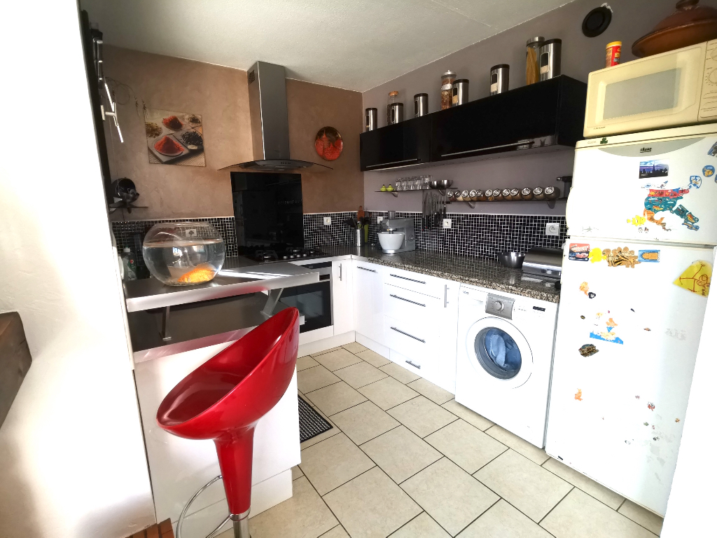 BEAU REZ-DE-JARDIN AVEC GARAGE ET PLACE DE PARKING PRIVATIVE 3/10